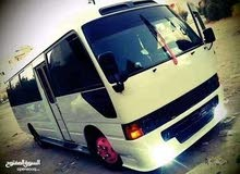 Toyota Coaster car is available for a Year rent