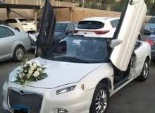 للزفاف كريسلر سيبرينغ معدل بسائق للزفاف