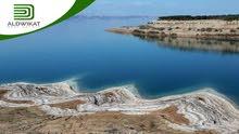 ارض للبيع في الغور الجنوبي (مطلة على البحر) بمساحة 852 م