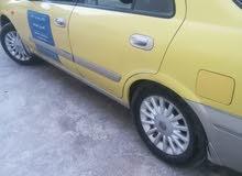 تكسي عمومي نيسان صن2009 الزرقاء للبيع بحالة جيدة للبيع