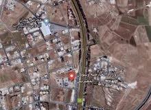ارض للبيع  قرب وزاره الخارجية شارع المطارمساحة 2 دونم واجهة 70 متر تصلح لعدة مشاريع
