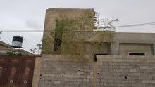 منزل للبيع نصف تشطيب تاجوراء طريق المصانع
