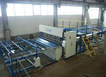 Machine à souder pour la production de treillis d'armature, clôtures, gabions