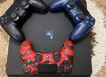 PlayStation 4 slim with 3 controllers and games