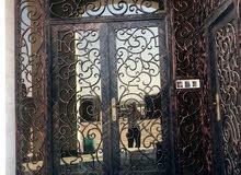 تصنيع جميع انواع الأبواب الحديد والكاست المنيوم