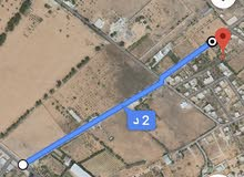 قطعة أرض في منطقة تاجوراء طريق المصانع.