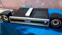 جهاز فلبس DVD و فلاش رام و اواكس ومسجل وراديو مع سماعتين وريمونت
