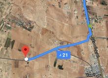 للبيع ارض 11 دونم في ام رمانه شارع 40 م للاستثمار