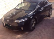 Automatic Black Kia 2010 for rent