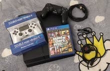 PS4 1TB AND 2 CONTROLLERS AND GTA GAME GREAT CONDITION