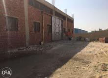 مصنع في ابورواش خلف القرية الذكية