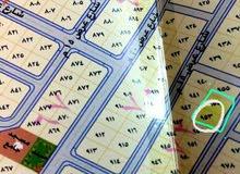 أرض سكنيه للبيع بالوسام 2 قريب من خط الدائري للملك فهد خلف محطة البنزين وقريب من