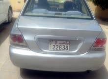 سياره متسوبيشي لانسر 2006 فضي بيمه سنه السعر 500 دينار