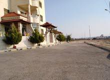قطعة أرض للبيع في منطقة الطنيب حوض العيادات بجانب جامعة الشرق الأوسط بقرب أيكيا منطقة فلل
