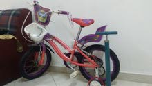 15 BHD Kids bicycle with training wheels+bicycle pump (Manama)