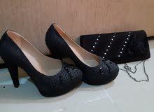 High heel shoes + bag
