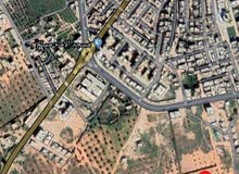 قطعة أرض طريق بني وليد خلف الهلال الأحمر(المركز الصحي غرب المدينة) الحي الجديد