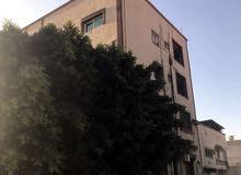 عمارة تجارية في سنتر قصر بن غشير