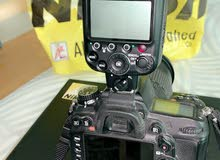 كاميرا نيكون D7000 وفلاش sb-910