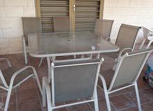 طاولة خارجية مع 8 كراسي للحديقة مستعملة