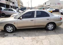 For sale a Used Kia  2000
