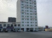 بنايه من 12 طابق سكني تجاري معبيله مقابل نيستوا