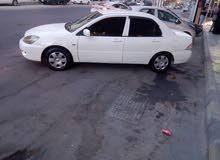سيارة متسوبيشي لانسر لون ابيض موديل 2011(تصلح اعفاء طبي)