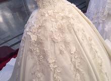 فستان زفاف مع الشرعه