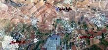قطعة أرض في منطقة ام رمانة جنوب عمان قريبة من كومباوند الأندلسية طريق المطار للبيع