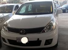 Used condition Nissan Tiida 2009 with +200,000 km mileage