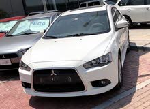 For sale Mitsubishi Lancer car in Abu Dhabi