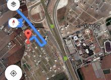 للبيع ارض 518 م في الطنيب شارعين مقابل جامعة الإسراء مباشره
