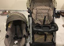 عجلة أطفال وكرسي سيارة بحالة ممتازة