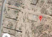 قطعة ارض مساحتها 500 متر مربع شمال منطقة الأفران بالعجيلات وجنوب طريق السكة صالح