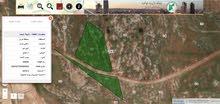 ارض 3 دونمات و 900 متر خلف جامعة جرش منطقة شاليهات وفلل للبيع او البدل بسيارة