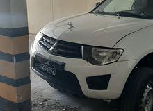 للبيع سياره مستبيشي 2013 بترول ماشي 200000 كيلو السياره نظيفه استعمال شخصي