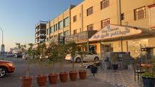 بناية ف سوق الخوض اول خط سكني تجاري