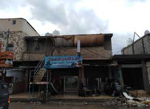 بناية للبيع عمار جديد مأجرة كاملة توجد على الشارع الرئيسي قريبا من الخدمات العامة