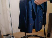 مكواة ملابس بالبخار
