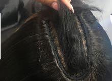 شعر طبيعي لون اسود متوسط الطول