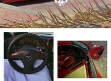 كورفيت مديل 2006 امريكي اللون احمر حالته ممتازه