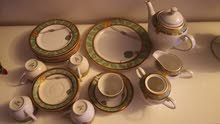 tea cups set and plates cake