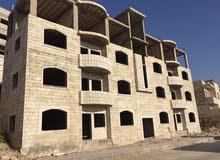 عمارة سكنية عظم ( غير مشطبة ) للبيع قرب جرش مول