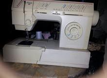 ماكينة خياطة منزلية نوع سنجر بحال الجديد تطريز فتح عراوي تركيب أزرار ممتازه جداً