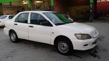 Used condition Mitsubishi Lancer 2001 with +200,000 km mileage