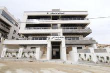 شقة ارضية مميزة جداً للبيع في اجمل موقع على طريق المطار