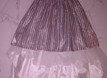 فستان جديد بقرطاسه