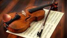 مدربة الة الكمان