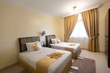 غرفة وصالة شقق فندقية علي شارع خليفة الرئيسي فرش نظيف قريب من الخدمات