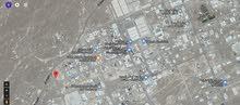 فرصة ذهبية الايجار ارض الصناعية فلج العوهي على الشارع الرئيسي